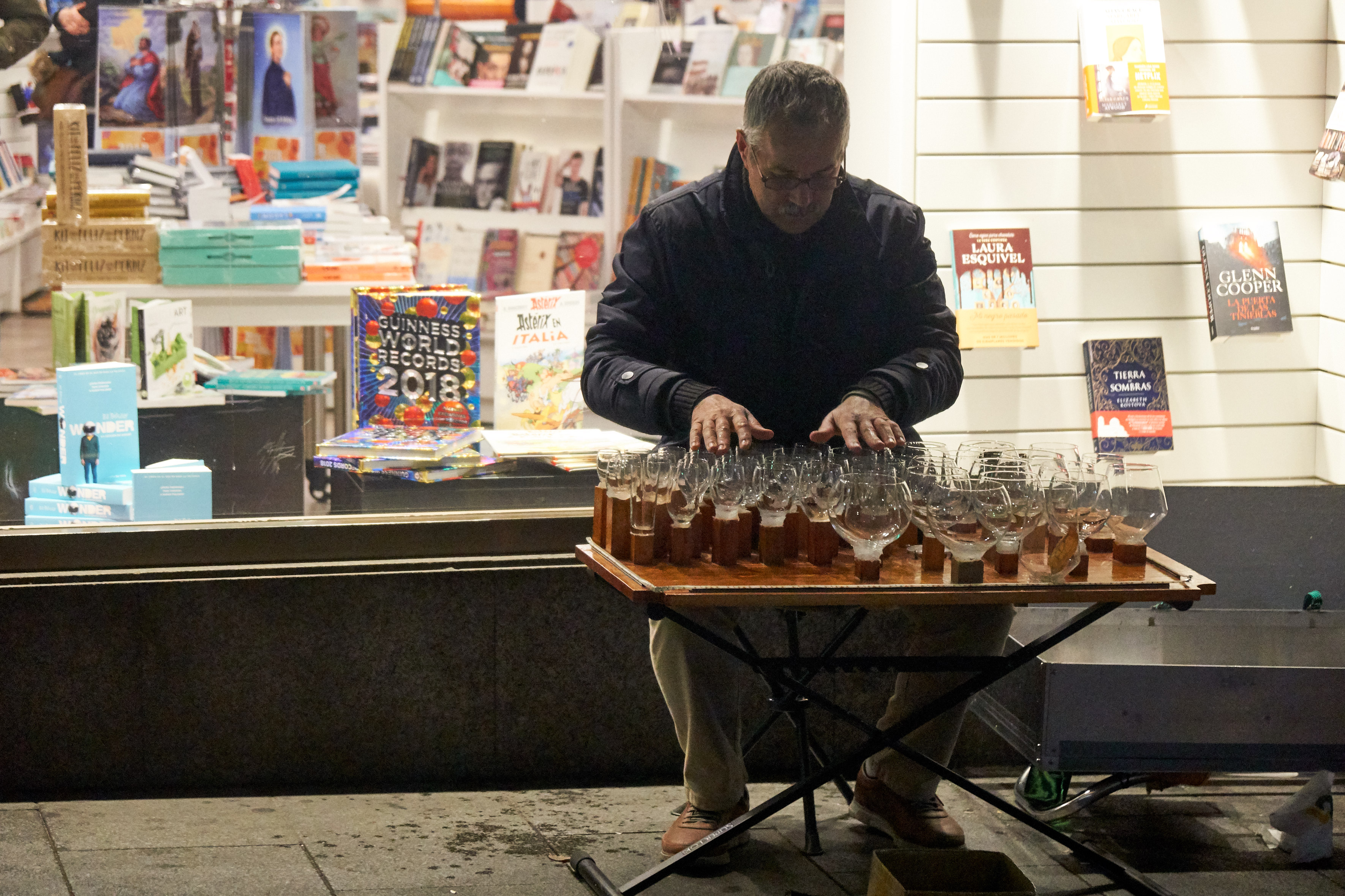 Glass organ player in the night